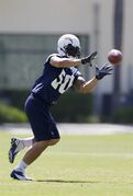 San Diego Chargers rookie linebacker Manti Te'o grabs a catch during Chargers training camp Monday, May 20, 2013, in San Diego. (AP Photo/Gregory Bull)
