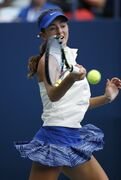 CiCi Bellis, of the United States, returns a shot against Renata Zarazua, of Mexico, during the first round of juniors play at the 2014 U.S. Open tennis tournament, Monday, Sept. 1, 2014, in New York. (AP Photo/Seth Wenig)