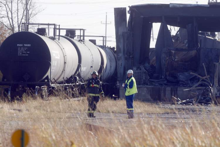 Wpg Fire investigators are on scene checking out 4 tanker rail cars and a tanker truck at the scene of  last evenings fire.  Fire aftermath from a large fire that destroyed Speedway International at Nicholas Ave near Marion St.  KEN GIGLIOTTI  / WINNIPEG FREE PRESS  /  OCT. 2  2012 (KEN GIGLIOTTI / WINNIPEG FREE PRESS)