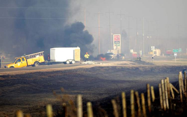 Bridge east of Vita on fire, Oct. 2. (BORIS MINKEVICH / WINNIPEG FREE PRESS)