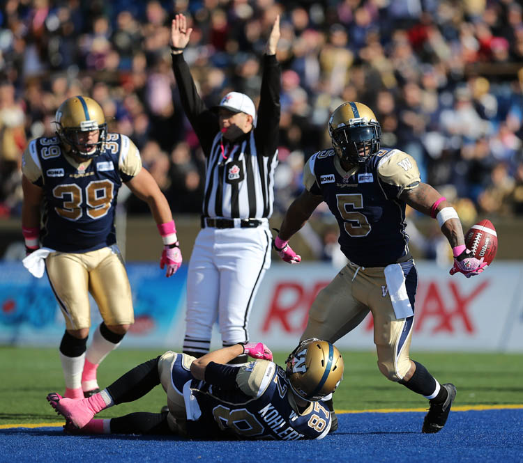 Winnipeg Blue Bombers' Chad Simpson (5), right, celebrates after scoring a touchdown against the Calgary Stampeders' during the first half of CFL football action at Canad Inns Stadium, Saturday, October 13, 2012.