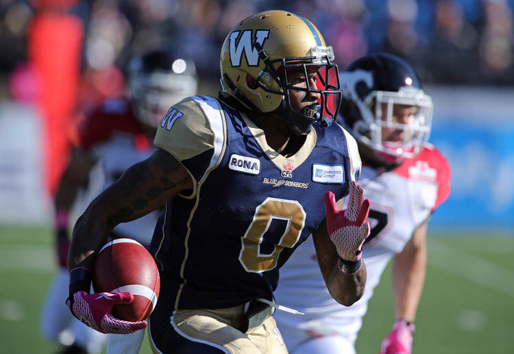 Winnipeg Blue Bombers' Johnny Sears (0) carries the ball against the Calgary Stampeders' during the first half of CFL football action at Canad Inns Stadium, Saturday, October 13, 2012.