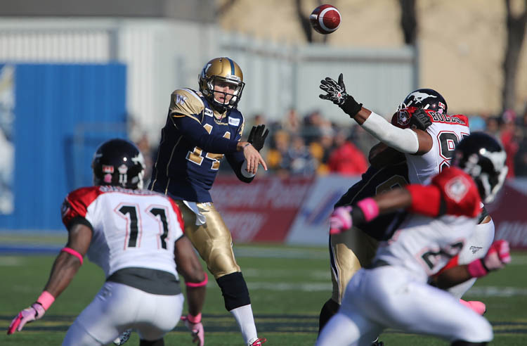 Winnipeg Blue Bombers' quarterback Joey Elliot (14) passes against the Calgary Stampeders' during the first half of CFL football action at Canad Inns Stadium, Saturday, October 13, 2012.