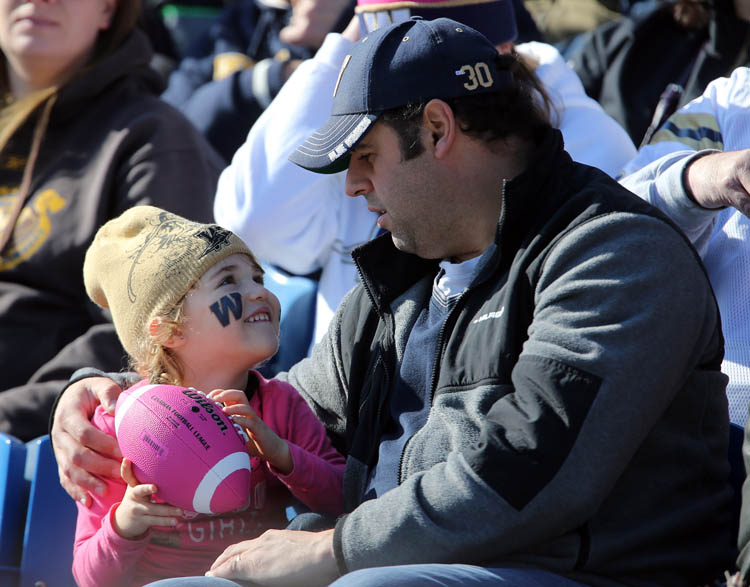Bobby Baker with his daughter, Nahanni, 4, in the stands at the Winnipeg Blue Bombers versus Calgary Stampeders game at Canad Inns Stadium, Saturday, October 13, 2012.