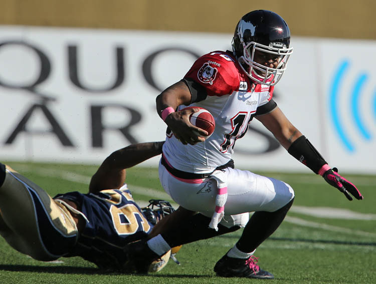 Winnipeg Blue Bombers' Fernand Kashama (56) sacks Calgary Stampeders' quarterback Kevin Glenn (15) during the second half of CFL football action at Canad Inns Stadium, Saturday, October 13, 2012. (TREVOR HAGAN/WINNIPEG FREE PRESS)