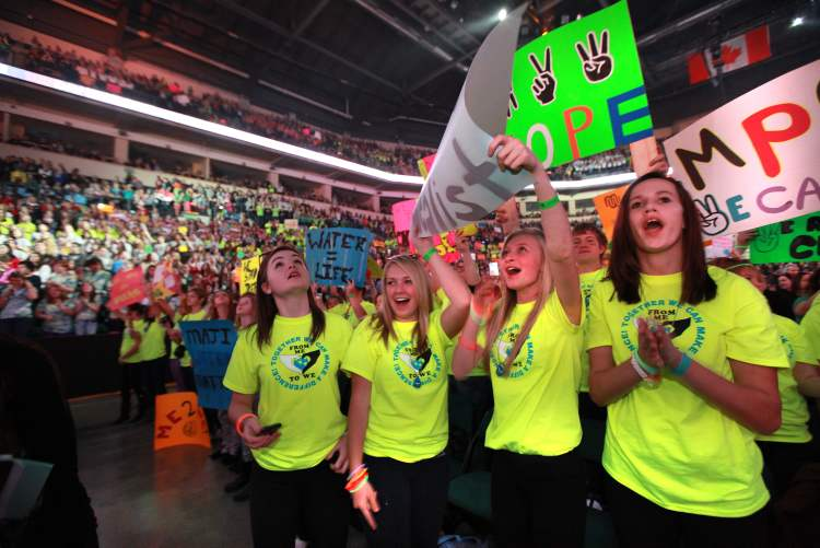 Students from all over Manitoba start screaming and standing in the aisle with their signs as We Day 2012 gets underway at the MTS Centre Tuesday morning.