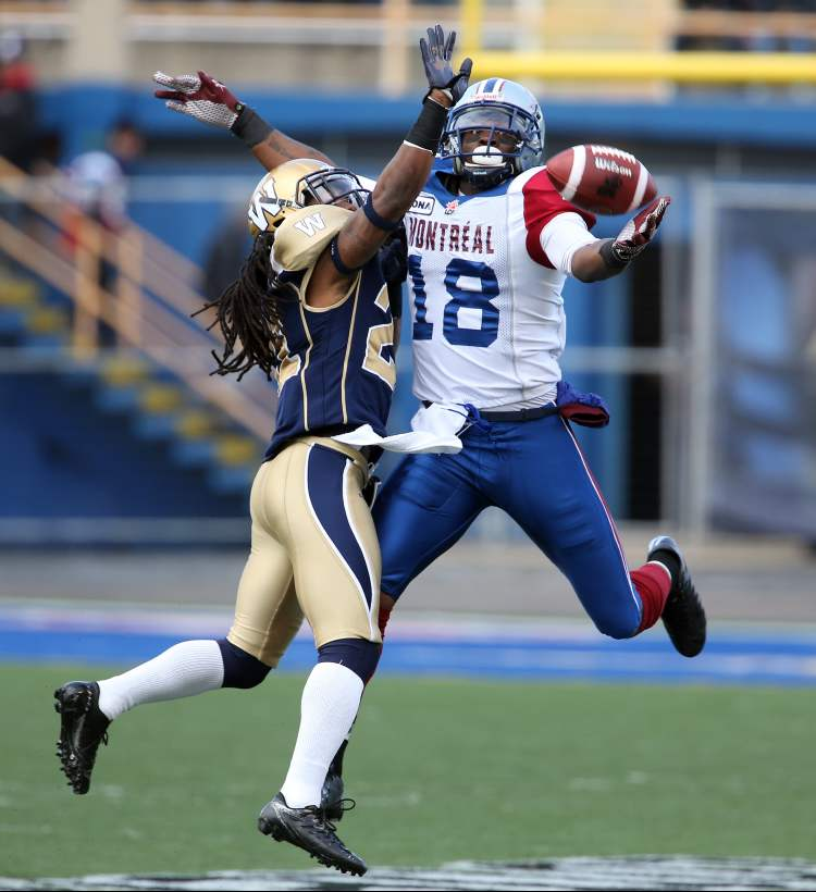 Winnipeg Blue Bombers' Alex Suber (21) puts a hand in the face of Montreal Alouettes' Jamel Richardson (18) during the first quarter of CFL action in the final game at Canad Inns Stadium, Saturday.