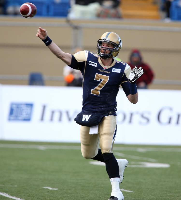 Winnipeg Blue Bombers' Alex Brink (7) throws a pass against the Montreal Alouettes' during the first half of CFL action in the final game at Canad Inns Stadium, Saturday.