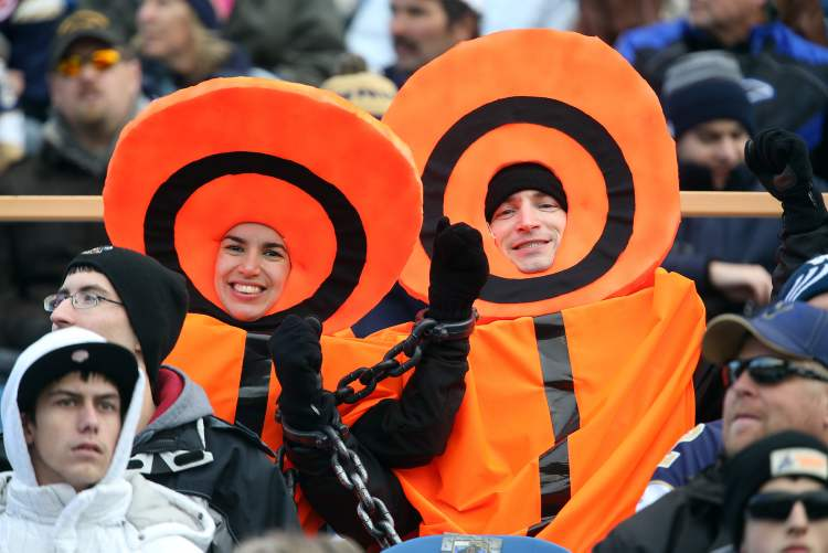 A couple of fans dressed as yard markers watching the Winnipeg Blue Bombers and the Montreal Alouettes in the final game at Canad Inns Stadium, Saturday.  (TREVOR HAGAN/WINNIPEG FREE PRESS)