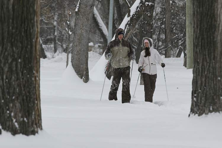 Nathan Ashmead and Allison Bingham cross-country ski down Wellington Crescent Sunday.