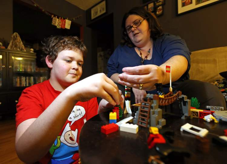 Gavin Walberg, 11, and his mom, Charlene. Gavin has Asperger's Syndrome.