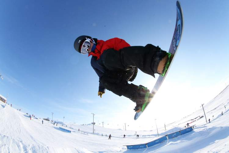 Snowboarder Colin Jakilazek, 21, does a grab while jumping over a tabletop. (TREVOR HAGAN / WINNIPEG FREE PRESS) (Trevor Hagan / Winnipeg Free Press)