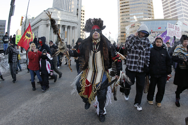 Idle No More protesters on Main Street. (JOHN WOODS / WINNIPEG FREE PRESS)