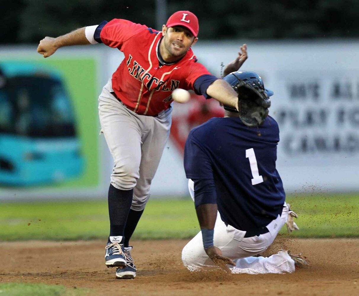 Lincoln Saltdog #4 Mike Gilmartin reaches in vain for the throw as Winnipeg Goldeyes #1 Reggie Abercrombie slides safely into second in the bottom of the second inning Wednesday evening at Shaw Park. (Phil Hossack / Winnipeg Free Press)