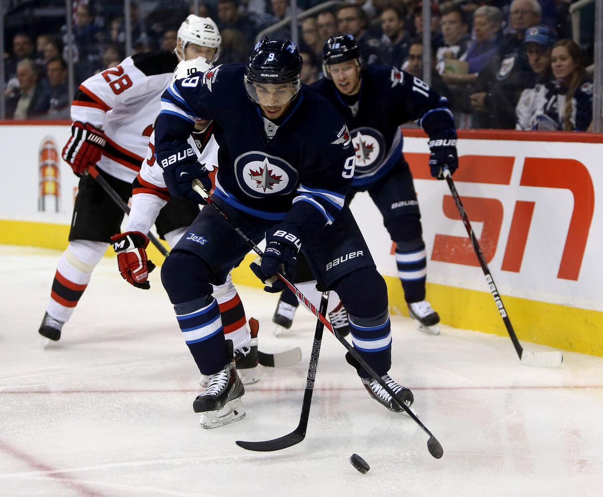 Evander Kane carries the puck the during second period. (Trevor Hagan / The Canadian Press)