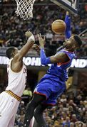 Philadelphia 76ers' Nerlens Noel, right, loses the ball against Cleveland Cavaliers' Tristan Thompson in the second quarter of an NBA basketball game Sunday, March 29, 2015, in Cleveland. (AP Photo/Mark Duncan)
