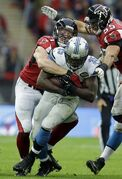 Detroit Lions running back Joique Bell (35) is tackled by Atlanta Falcons outside linebacker Kroy Biermann (71) in the second half of the NFL football game at Wembley Stadium, London, Sunday, Oct. 26, 2014. (AP Photo/Matt Dunham)