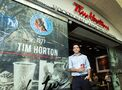 Tim Hortons parent company says president Alex Macedo has 'chosen to leave.'