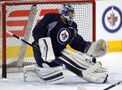 Pavelec undergoes knee surgery, out at least two weeks