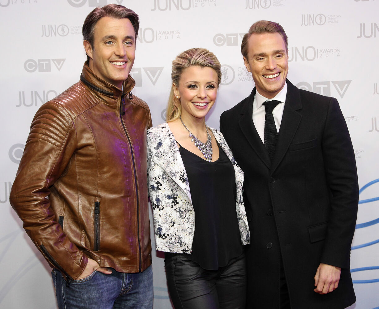 CTV's eTalk hosts Ben Mulroney, Danielle McGimsie and Devon Soltendieck arrive on the Junos 2014 red carpet.