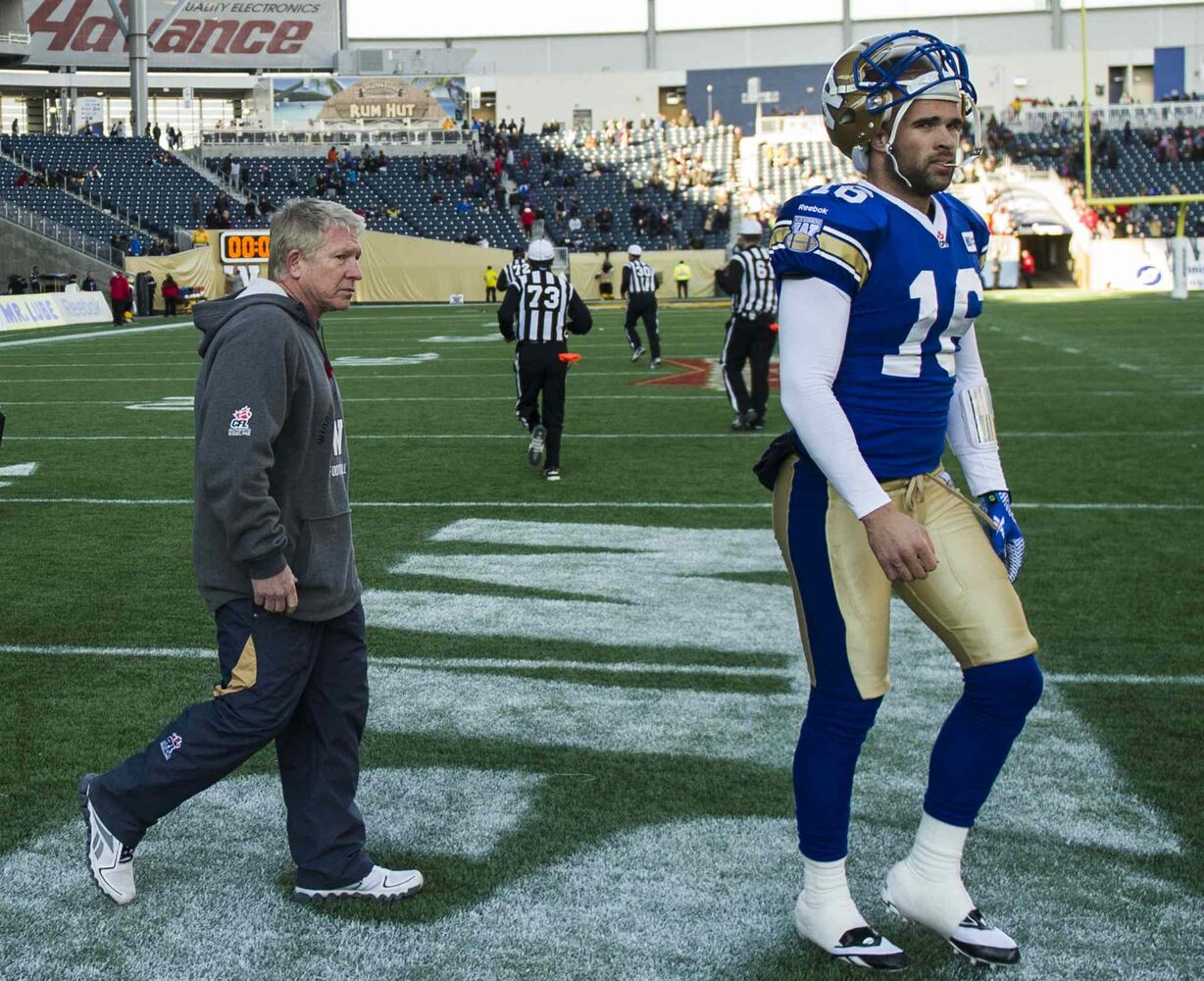 Winnipeg Blue Bombers head coach Tim Burke and quarterback Jason Boltus walk off of the field after the game. (David Lipnowski / Winnipeg Free Press)
