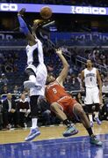 Milwaukee Bucks' Jared Dudley (9) falls to the floor as he is fouled by Orlando Magic's Victor Oladipo, left, while going up for a shot during the first half of an NBA basketball game, Thursday, Jan. 29, 2015, in Orlando, Fla. (AP Photo/John Raoux)