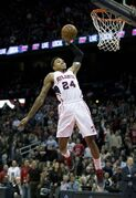 CORRECTS TO PORTLAND TRAIL BLAZERS, INSTEAD OF INDIANA PACERS - Atlanta Hawks guard Kent Bazemore scores against the Portland Trail Blazers during the first half of an NBA basketball game Friday, Jan. 30, 2015, in Atlanta. (AP Photo/John Bazemore)