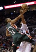 Portland Trail Blazers forward LaMarcus Aldridge, right, blocks a shot by Milwaukee Bucks forward Giannis Antetokounmpo, from Greece, during the first half of an NBA basketball game in Portland, Ore., Wednesday, Dec. 17, 2014.(AP Photo/Don Ryan)
