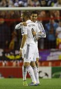 Real Madrid's Karim Benzema, left, celebrates with Cristiano Ronaldo after scoring his side's second goal during the Champions League group B soccer match between Liverpool and Real Madrid at Anfield Stadium, Liverpool, England, Wednesday Oct. 22, 2014. (AP Photo/Jon Super)