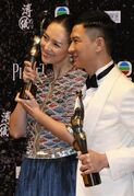 "Chinese actress Zhang Ziyi, left, and actor Nick Cheung Ka-fai pose after winning the Best Actress award for her movie ""The Grandmaster"" and Best Actor awards for his movie ""Unbeatable"" of the 33rd Hong Kong Film Awards in Hong Kong Sunday, April 13, 2014. (AP Photo/Kin Cheung)"