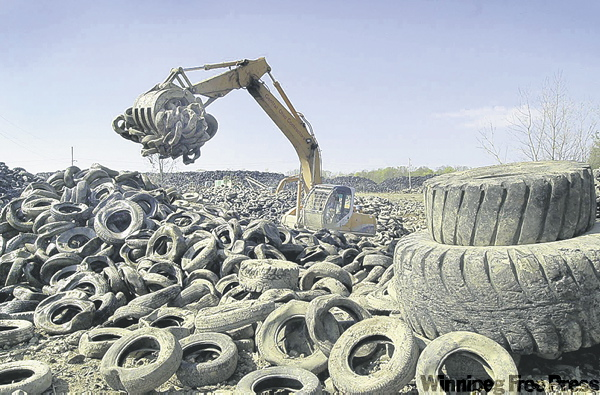 The associated press archives Old tires will be mixed with asphalt and used to cover a stretch of Portage Avenue this month.