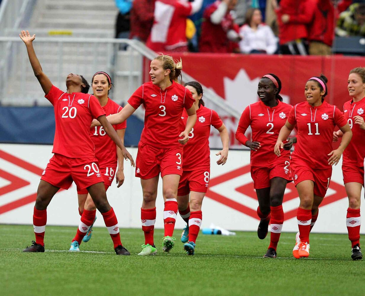 Kadeisha Buchanan (#20), left, celebrates her goal with Canada teammates during the first half of Thursday's soccer game against Team USA.  (Ruth Bonneville / Winnipeg Free Press)