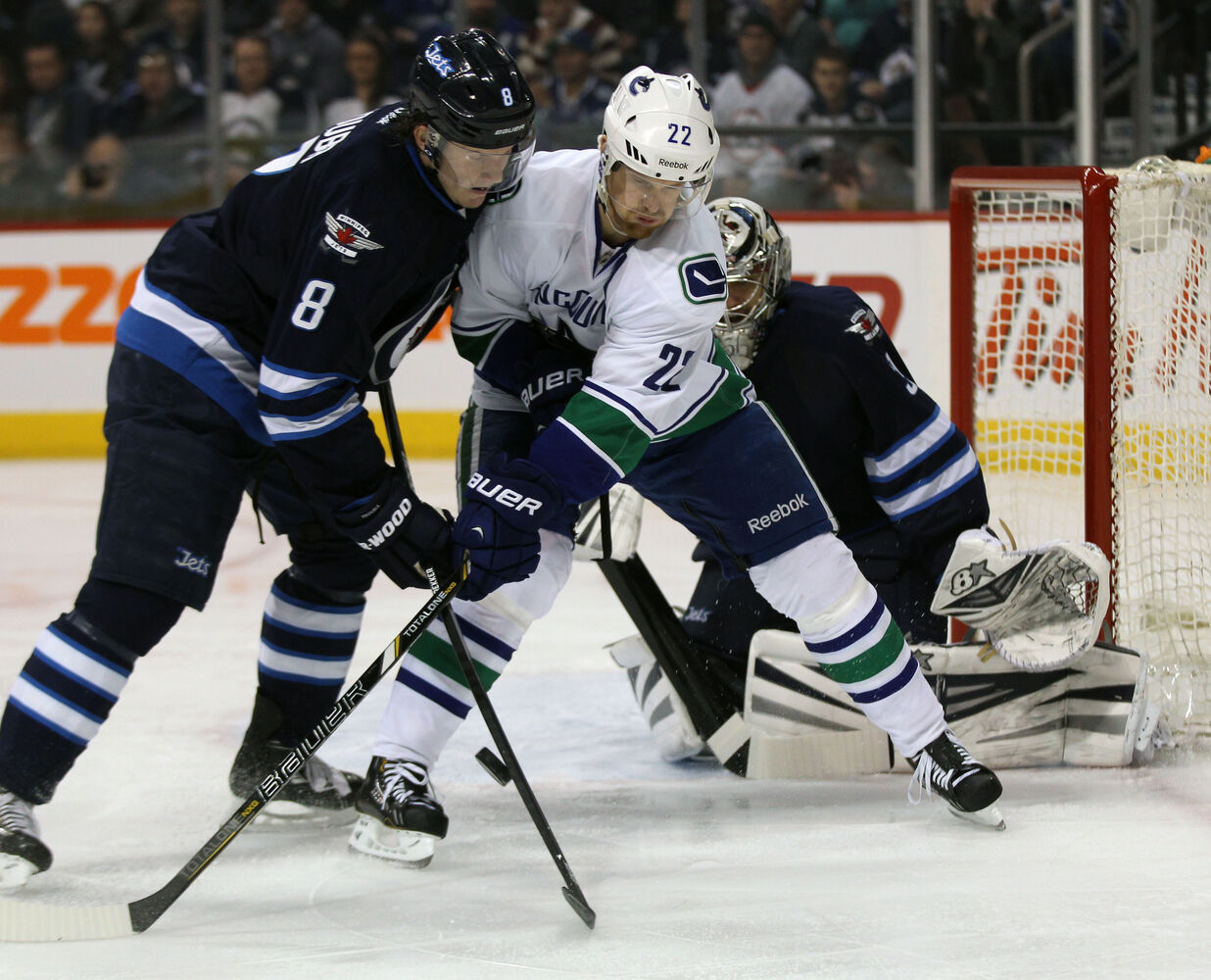 Winnipeg Jets' Jacob Trouba ties it up with Vancouver Canucks' Daniel Sedin during the first period of Friday's game in Winnipeg. (JOE BRYKSA/ WINNIPEG FREE PRESS)