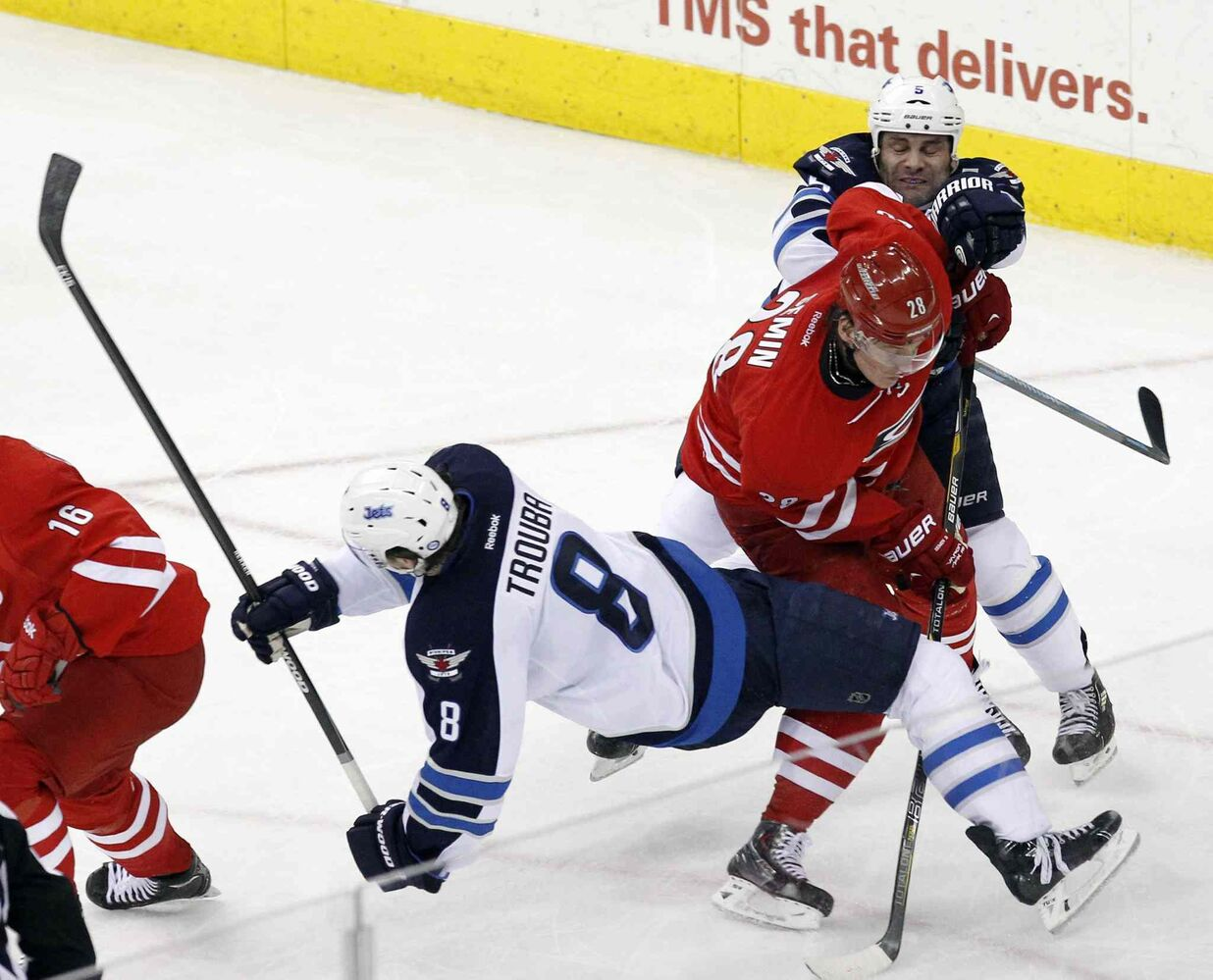 Carolina Hurricanes' Alexander Semin (28) and Winnipeg Jets' Jacob Trouba (8) and Mark Stuart (5) collide during the second period of Tuesday's game. (Chris Seward / Raleigh News & Observer/ Tribune Media MCT)