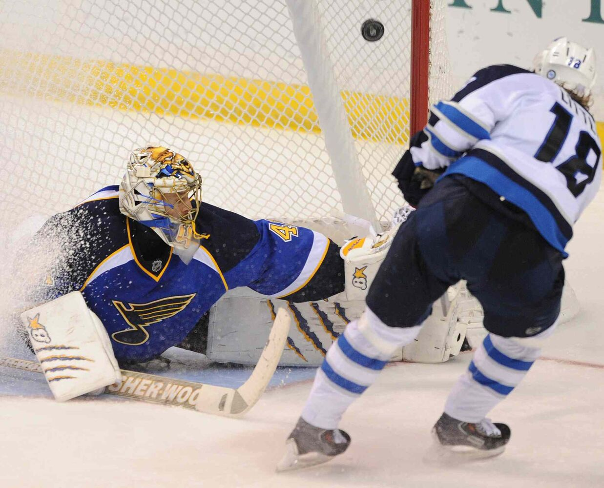 St. Louis Blues goalie Jaroslav Halak can't block a goal by Winnipeg Jets forward Bryan Little during the third period of an NHL game in St. Louis Tuesday. The Blues won 3-2.