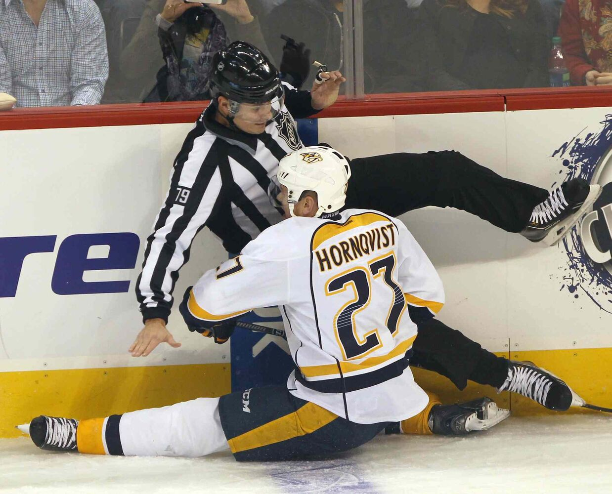 Nashville Predators forward Patric Hornqvist is tangled up with referee Kiel Murchison during the first period.