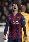 Barcelona's Luis Suarez reacts during a Champions League Group F soccer match between APOEL and FC Barcelona at GSP stadium, in Nicosia, Cyprus, Tuesday, Nov. 25, 2014. (AP Photo/Petros Karadjias)