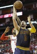 Cleveland Cavaliers' Kevin Love (0) goes to the basket with Houston Rockets' Josh Smith (5) at his back in the first half of an NBA basketball game Sunday, March 1, 2015, in Houston. (AP Photo/Pat Sullivan)
