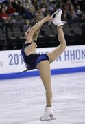 Gracie Gold, of the United States, competes in the ladies short program at the Skate America figure skating event Saturday, Oct. 25, 2014, in Hoffman Estates, Ill. (AP Photo/Nam Y. Huh)