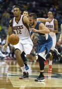 Minnesota Timberwolves' J.J. Barea, right, and Milwaukee Bucks' Jabari Parker, left, collide at midcourt during the second half of an NBA basketball game Wednesday, Oct. 22, 2014, in Milwaukee. (AP Photo/Tom Lynn)