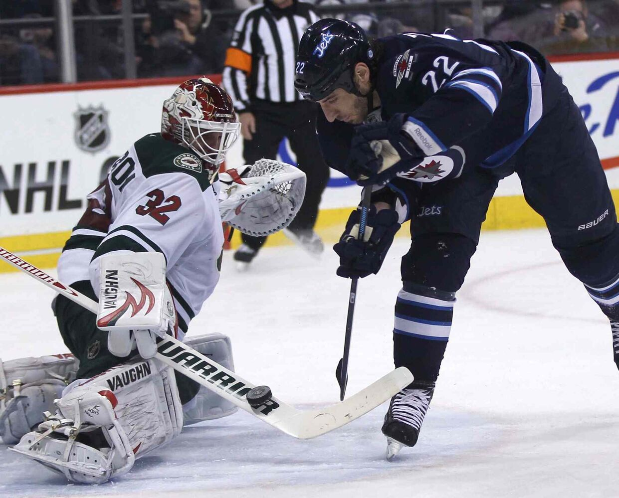 Winnipeg Jets forward Chris Thorburn is stymied by Minnesota Wild goaltender Niklas Backstrom during the second period.