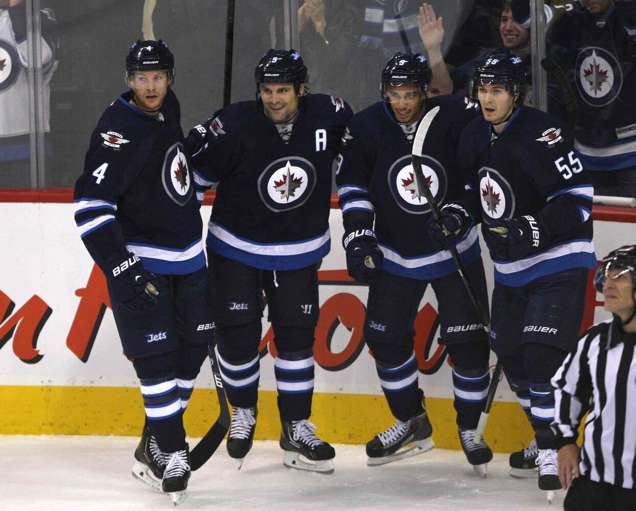 Winnipeg Jets (from left) Paul Postma, Mark Stuart, Evander Kane, and Mark Scheifele celebrate Kane's first-period goal.