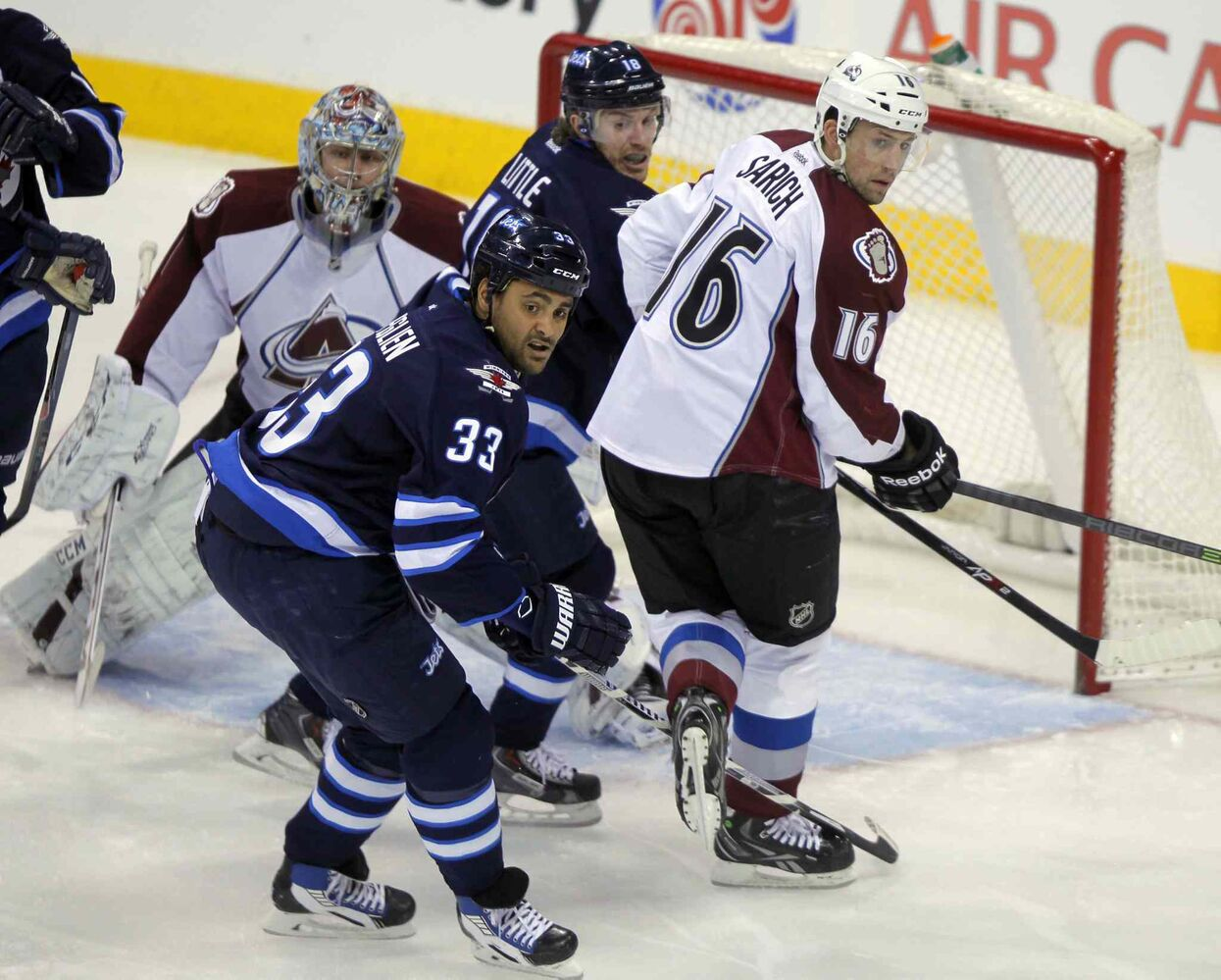 From left: Semyon Varlamov, Dustin Byfuglien, Bryan Little and Cory Sarich track the puck in the first period. (BORIS MINKEVICH / WINNIPEG FREE PRESS)
