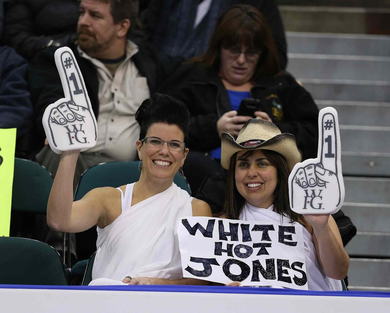Fans cheer on Jennifer Jones and her team as they defeated Sherry Middaugh in the women���s final of Roar of the Rings curling at the MTS Centre on Sat., Dec. 7, 2013 to win the right to represent Canada at the Winter Olympics in Sochi, Russia, in February. Photo by Jason Halstead/Winnipeg Free Press