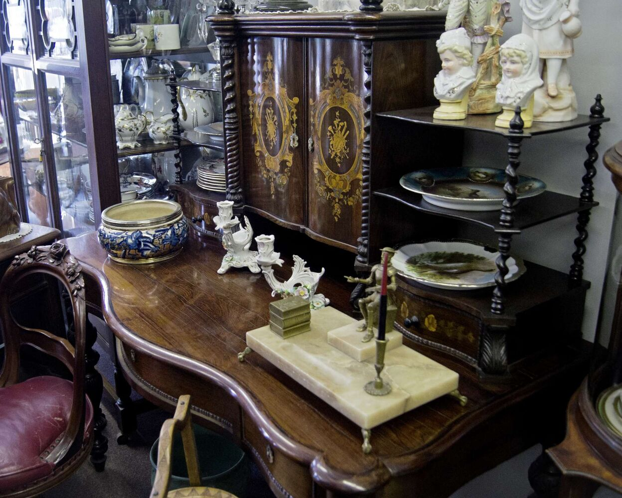 """What is one piece you would be sad to see go? There are many examples of Winnipeg's rich history at Selim's. This circa 1880s desk, inlaid with rosewood and Mother of Pearl, from England, was found in a Winnipeg home. """"It's the workmanship here. This is solid rosewood that's been s-curved. Just those two doors are some of the most incredible bits of workmanship I've seen in a piece of furniture."""