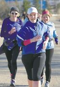 Grace Romund, a Running Room instructor, leads a group of runners training for the full and half marathons up the hill  at Westview Park this week.