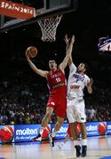 Serbia's Nikola Kalinic pushes the ball up the basket against France's Joffrey Lauvergne during a basketball World Cup semifinal match between France and Serbia at the Palacio de los Deportes stadium in Madrid, Spain, Friday, Sept. 12, 2014. (AP Photo/Daniel Ochoa de Olza)