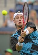 Lleyton Hewitt, of Australia, returns a shot against Matthew Ebden, of Australia, during a first round match at the BNP Paribas Open tennis tournament, Thursday, March 6, 2014, in Indian Wells, Calif. (AP Photo/Mark J. Terrill)