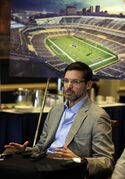 Dave Peacock, a leader in the effort to build a new NFL stadium in St. Louis, smiles along side an artist's rendering of the project while speaking with the media Friday, April 24, 2015, in St. Louis, two days after making a presentation to the league. Peacock and his partner in the effort, Bob Blitz, say they remain optimistic about a plan that they say would keep a team and help redevelop a blighted part of the city.(AP Photo/Jeff Roberson)