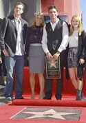 FILE - In a Monday, Nov. 16, 2009 file photo, actor John Stamos, second right, is joined by former cast members from the family comedy series,